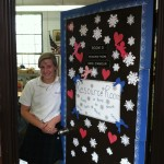 Caroline in front of one of her decorated doors at St. Jane de Chantal School